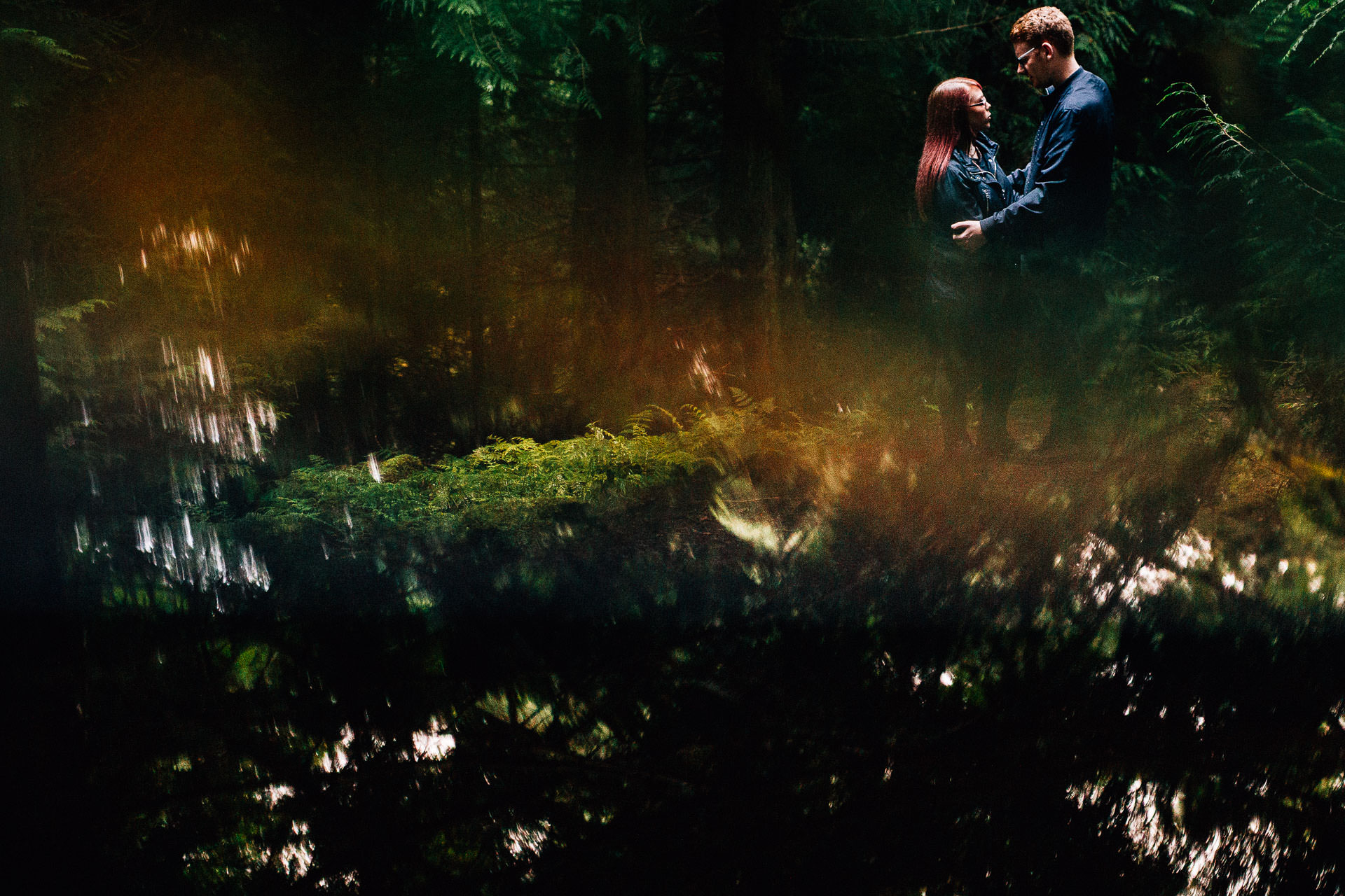 Whinlatter Pre Wedding Shoot Lake District - N&P - reflection shot of couple kissing in the woods